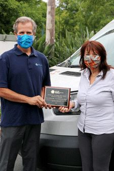 Paul Jaconette, DWW–SBSM Board president and CenCal Health COO, shares plaque with Marguerite Sanchez, co-founder, board secretary/treasurer of Doctors Without Walls – Santa Barbara Street Medicine.