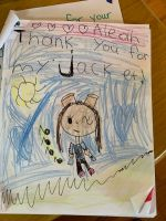 Student letters and drawings show their appreciation for jackets they received from the Santa Barbara Education Foundation.