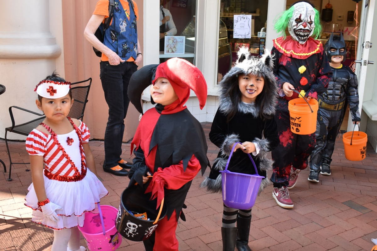 young ghosts & goblins join the halloween celebration in downtown