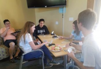 Cards and cookies: UCSB's bridge club in pre-pandemic times.