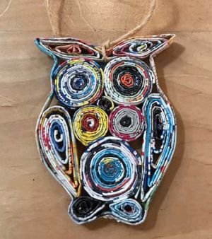 Owl ornament made from recycled magazines.
