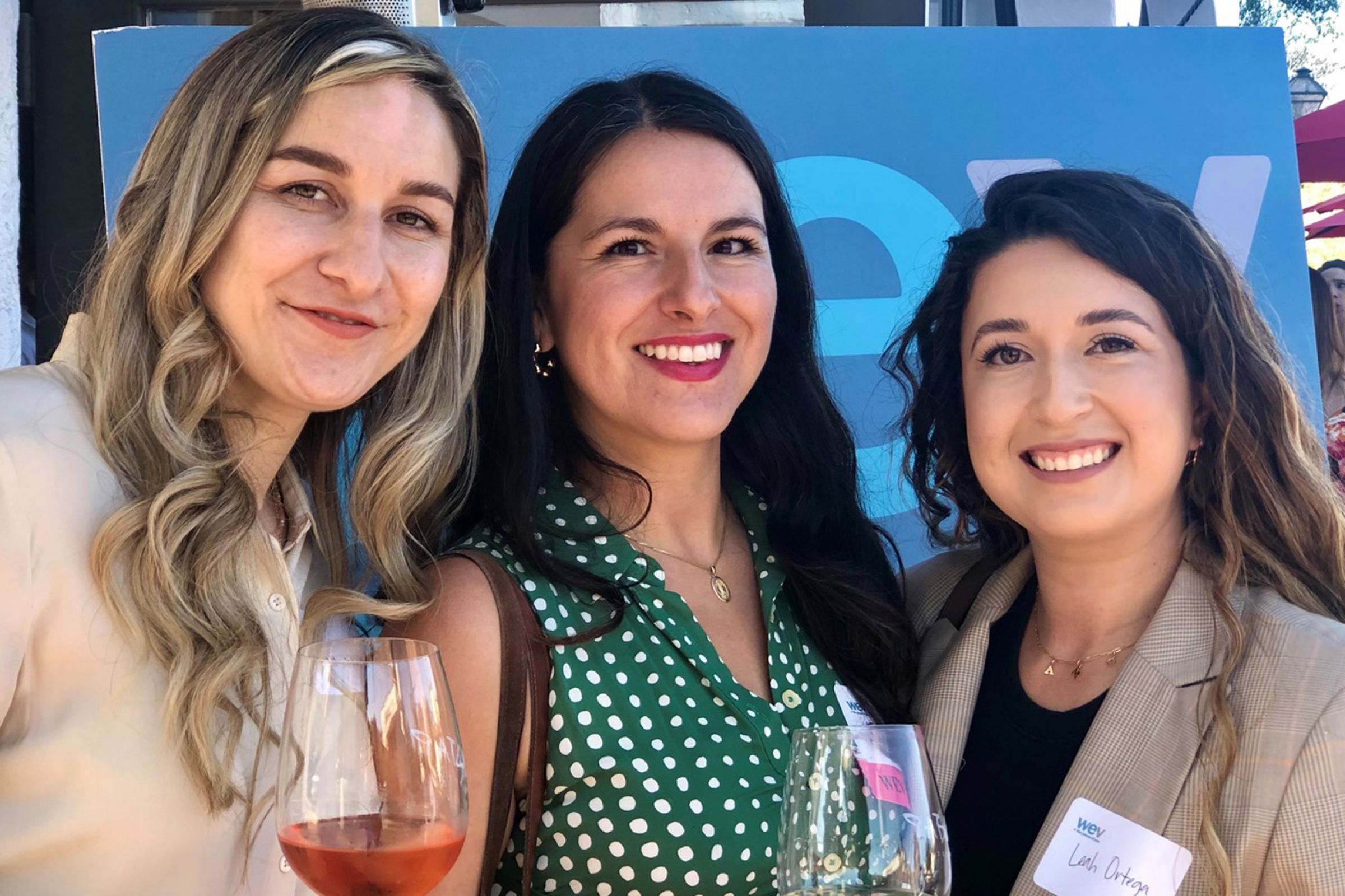 Elysia Guillen, left, Lili Munoz and Leah Ortega attend Tuesday's open house at Women's Economic Ventures' expanded space in the historic El Centro building in downtown Santa Barbara.