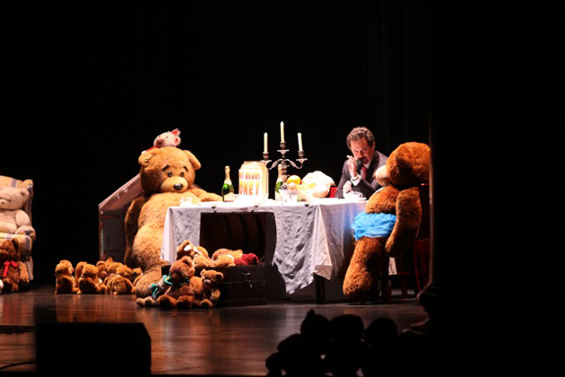 "Master of Ceremonies Dennis Miller chats with his teddy bear friends on stage at the Teddy Bear Cancer Foundation's ""Evening of Laughter and Love."""