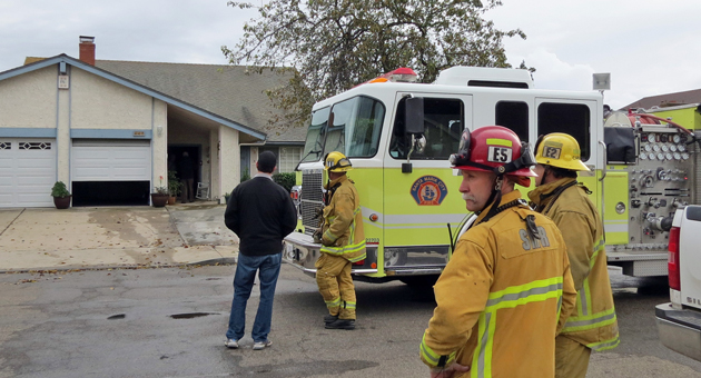 A family of four was forced out of their Santa Maria home Sunday afternoon by a fire that caused major damage to the two-story structure. (Gina Potthoff / Noozhawk photo)