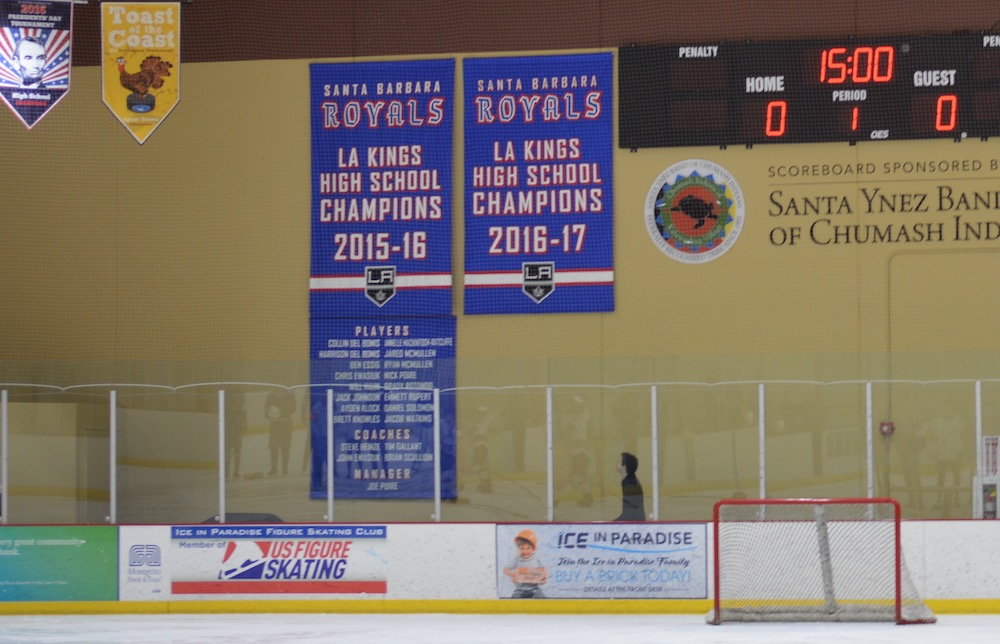 The L.A. Kings High School Hockey League championship banners for the Santa Barbara Royals hang behind the rink at Ice in Paradise