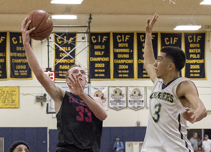 David Frohling of San Marcos drives to the hoop against Daniel Arzate of Dos Pueblos. Frohling scored a game-high 27 points.