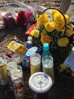 Flowers, candles and a Los Angeles Dodgers baseball are among the items at a makeshift memorial to Ryuta Yamaguchi, a Santa Ynez jogger who was struck by a vehicle and killed Dec. 27. (Dave Bemis photo)