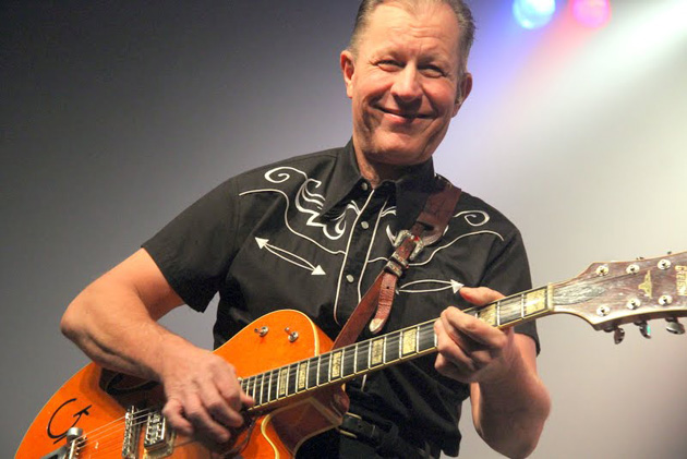 Guitarist and lead singer Jim Heath of the Reverend Horton Heat smiles for the camera while performing at the Majestic Ventura Theater. (L. Paul Mann / Noozhawk photo)