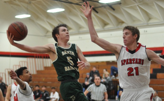 Ben Brown of Santa Barbara drives to the basket against Rio Mesa's Brandon Townley. Brown scored 23 points in the Dons' victory