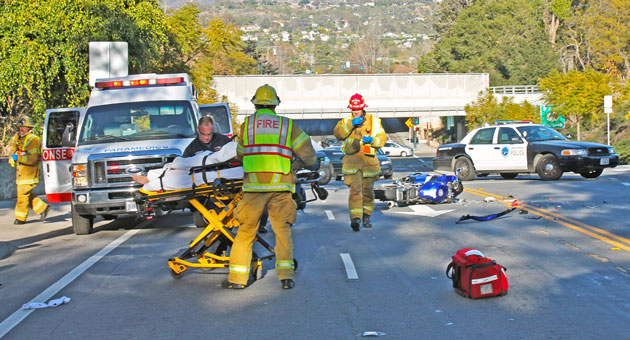 <p>Paramedics wheel a 24-year-old Goleta man to a waiting ambulance Sunday after he rear-ended a sedan on West Mission Street in Santa Barbara.</p>