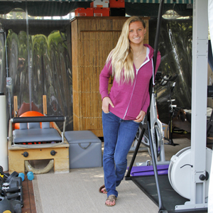 Surfer Lakey Peterson, seen in the home gym where she often trains, says she makes fitness a priority.