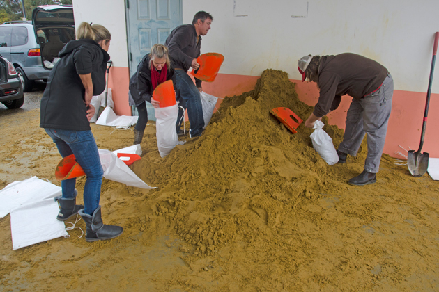 Santa Barbara-area residents fill sandbags as heavy rains continue Wednesday afternoon.