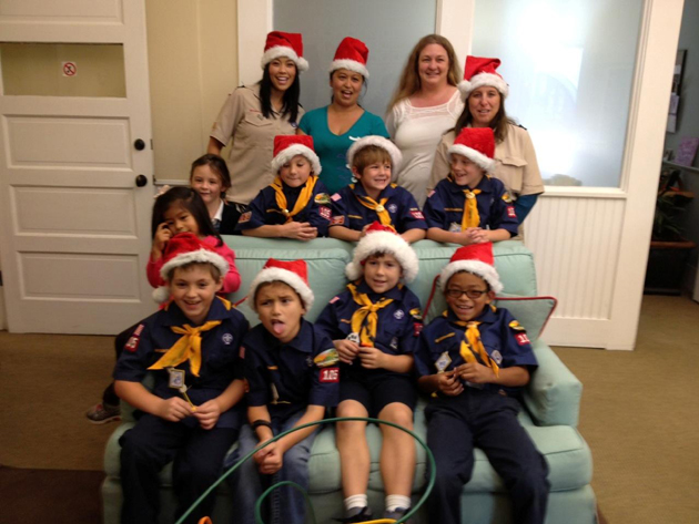 Members of Boy Scout Troop 105 show their Santa spirit while delivering presents to CALM families. (CALM photo)