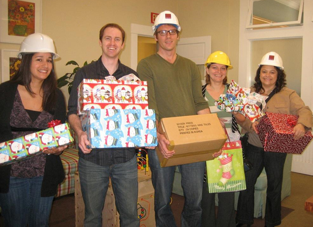 Architects from PMSM Architects deliver gifts at CALM for their adopted family. (CALM photo)