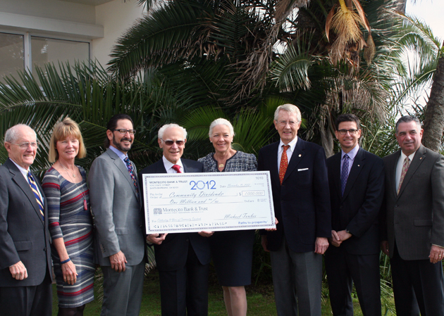 From left, Tom Fly, Cathy Carter-Duncan, Rob Skinner, Michael Towbes, Janet Garufis, Gerald Parent, Craig Zimmerman and Ken Verkler celebrate the distribution of $1 million to local nonprofits at the 10th Annual Montecito Bank & Trust Community Dividends Awards Luncheon held at the Four Reasons Resort The Biltmore Santa Barbara. (Melissa Walker / Noozhawk photo)