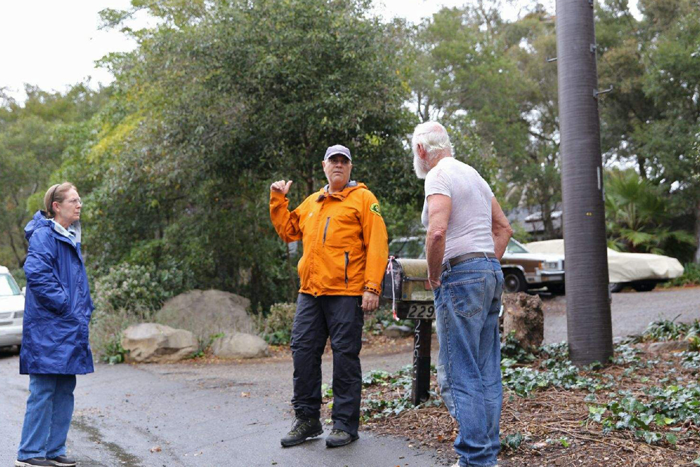 Santa Barbara County sheriff's deputies and Search and Rescue team members tell Montecito residents to leave the area ahead of the Jan. 9 storm. Debris flows from heavy rainfall subsequently killed 23 people and damaged or destroyed hundreds of homes.