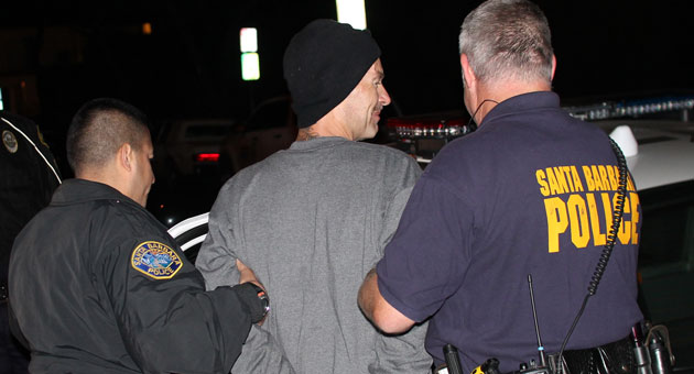 Suspected family feuder Nicola Zeno Mollo Jr. is hauled off to jail after a nearly nine-hour standoff with Santa Barbara police. Facing a multitude of felony charges and being held without bail, the parolee is likely to miss the next family reunion. (Urban Hikers photo)