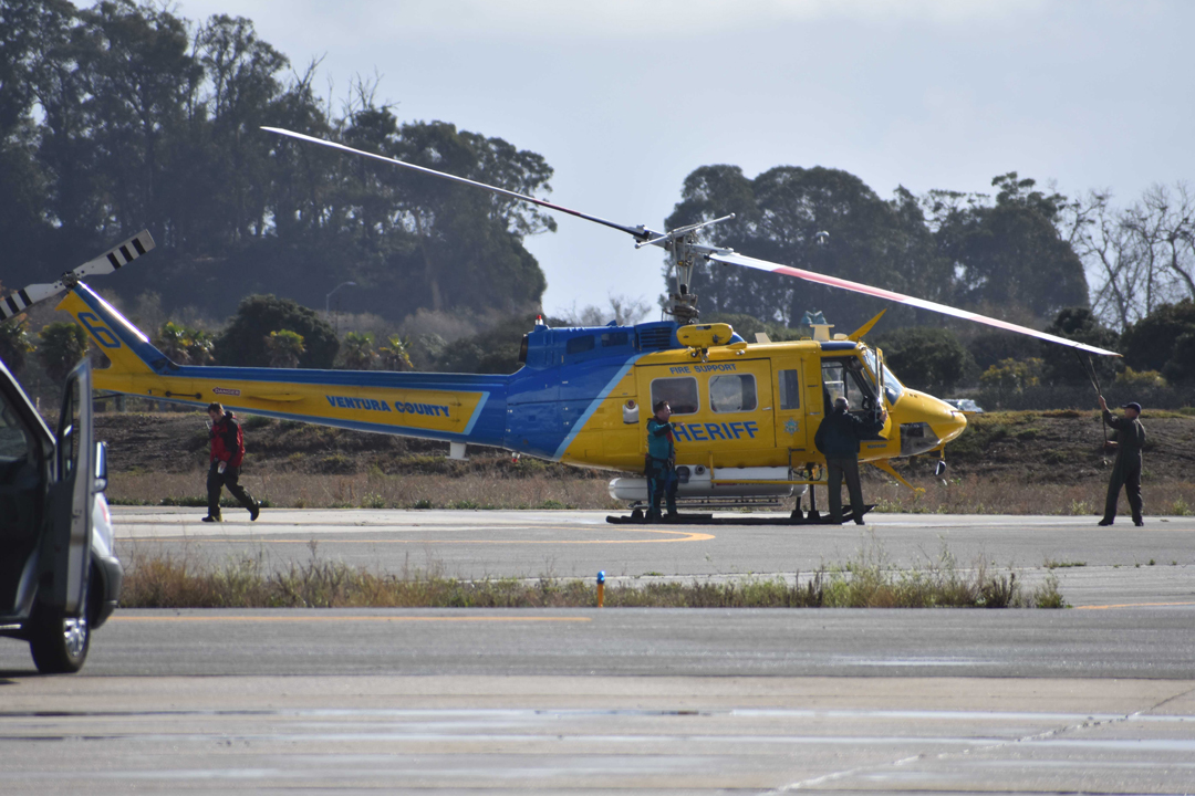Helicopters from the U.S. Coast Guard Santa Barbara and Ventura counties operate out of a helibase at the Santa Barbara Airport to help rescue Montecito-area residents Tuesday