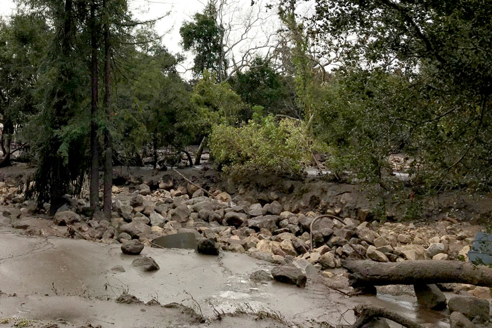 A section of creek in Montecito is full of boulders following the Jan. 9 flooding and mud and debris flows. Santa Barbara County crews and the U.S. Army Corps of Engineers are beginning work this week on clearing out key stretches of the creeks so they can better handle future downpours.