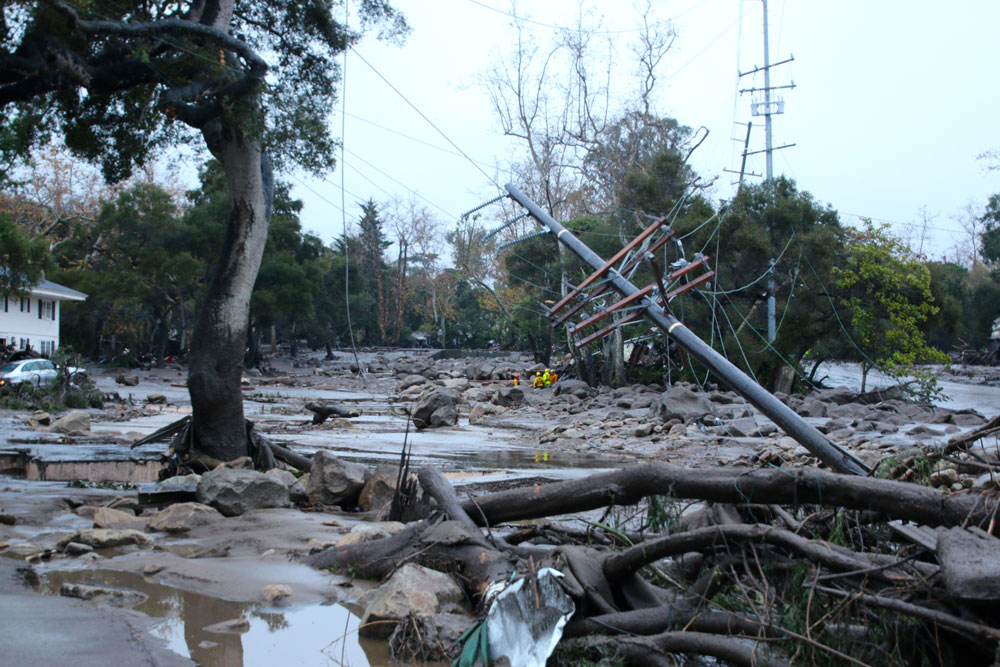 """Mud and debris inundate Olive Mill Road at Hot Springs Road in Montecito after the deadly Jan. 9 flash flooding. Officials say residents must remain in a state of """"storm readiness"""" due to the ongoing risk of flooding and mud and debris flows in neighborhoods below the Thomas Fire burn area."""
