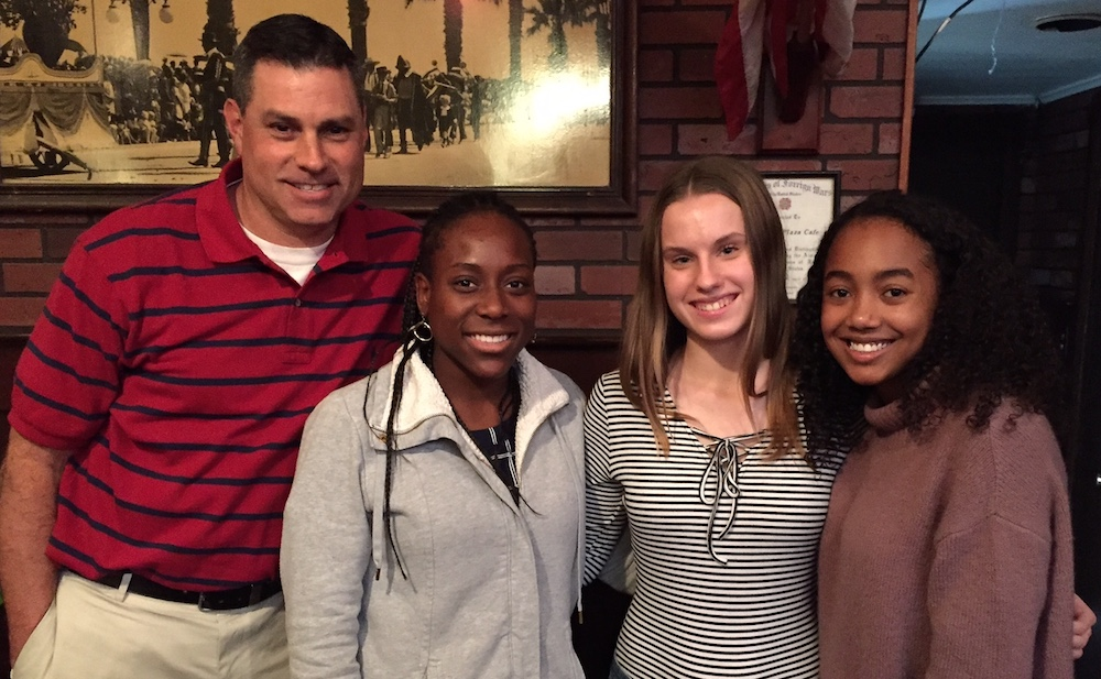 San Marcos basketball coach Chris Hantgin is joined by team members, from left: Milan McGary, Ashley Day and Fran Pereira at Monday's Round Table press luncheon.