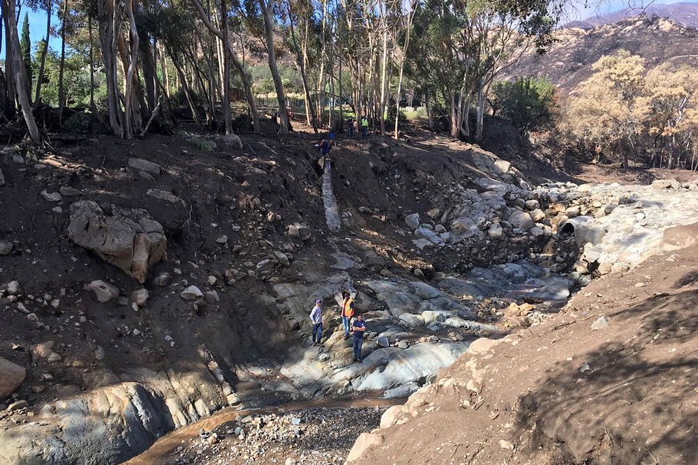 "Crews examine storm damage to the Montecito Water District's ""highline"" distribution water main."