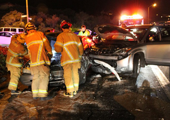 Santa Barbara firefighters respond to the scene of a two-vehicle collision Wednesday night at Miramonte Drive and Carrillo Street.