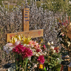 A cross has been placed along Highway 154 where two women were killed late last month when they were struck by vehicles. (Tom Bolton / Noozhawk photo)