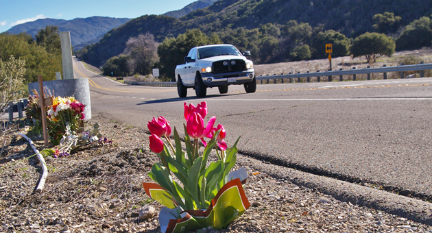 Flowers have been placed at a roadside memorial on Highway 154 where Sara Ornelas, 54, of Santa Barbara, and Barbara Romero , 49, of Lompoc were killed Dec. 21 after being struck by vehicles. Santa Barbara County Coroner's officials said Friday that both women had drugs in their systems at the time of their deaths. (Tom Bolton / Noozhawk photo)
