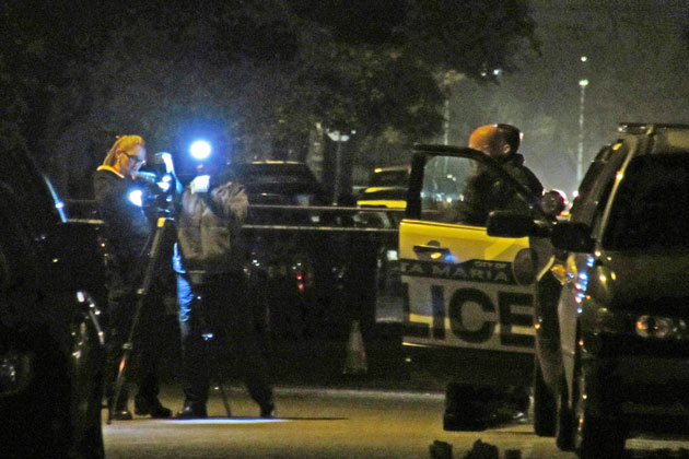 Crime-scene investigators gather evidence Tuesday night after two men were fatally wounded in shootings on a Santa Maria street.