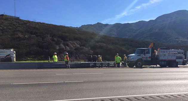 A Caltrans crew conducts guardrail duty at the scene of a fatal crash on Highway 101 along the Nojoqui Grade. (Claire Anderson / KEYT News photo)