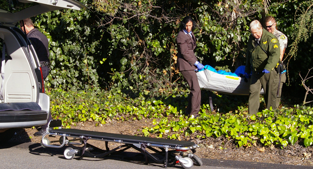 <p>The remains of a 41-year-old homeless man are removed from a makeshift campsite near the Arrellaga Street offramp from Highway 101 on Monday afternoon. Police said they believe he died of a drug overdose.</p>
