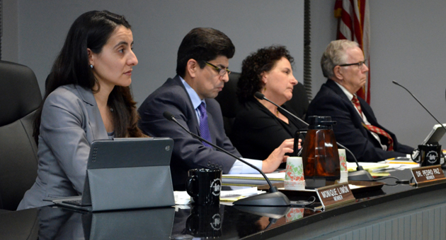 <p>Santa Barbara school board members have gone paperless for meetings, so they unanimously voted to start a student iPad pilot program from behind their own devices. Ed Heron, far right, is concerned that the devices will last only three years.</p>