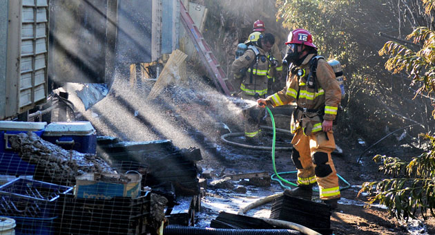 <p>Santa Barbara County firefighters douse a greenhouse fire that broke out Wednesday afternoon on More Mesa near Goleta.</p>