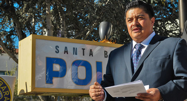 Attorney James Segall-Gutierrez stands in front of the Santa Barbara police station Friday while announcing a legal claim he has filed against the city for six people who say they were wrongly identified as gang members or associates. (Lara Cooper / Noozhawk photo)