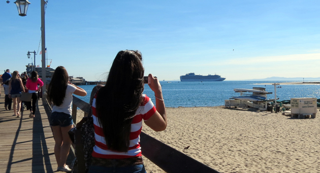 <p>Visitors and locals stop to marvel at the Sapphire Princess cruise ship that docked Friday at Santa Barbara&#8217;s waterfront. The luxury liner was the first of 18 that will arrive at the coastal city through May.</p>