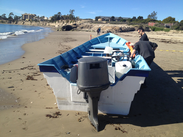 <p>Investigators examine a panga found in January at Goleta Beach near the UCSB campus. Authorities suspect it was used for smuggling, but no drugs or suspects were found.</p>