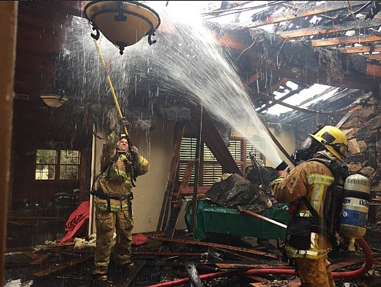 Santa Barbara County firefighters work to extinguish a fire at an Orcutt home Thursday morning.