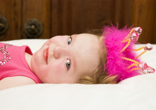 Gwendolyn Strong, now 2, was diagnosed at age 6 months with a degenerative motor neuron disease called Spinal Muscular Atrophy, which keeps her brain from producing the amount of protein needed to sustain vital muscles in her body