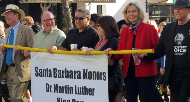 <p>Elected officials carry the banner for Monday&#8217;s march on State Street in Santa Barbara to the Arlington Theatre for a program in honor of Martin Luther King Jr. Day. From left are Santa Barbara City Councilmen Dale Francisco and Gregg Hart, Santa Barbara County supervisors Salud Carbajal and Janet Wolf, and Rep. Lois Capps.</p>