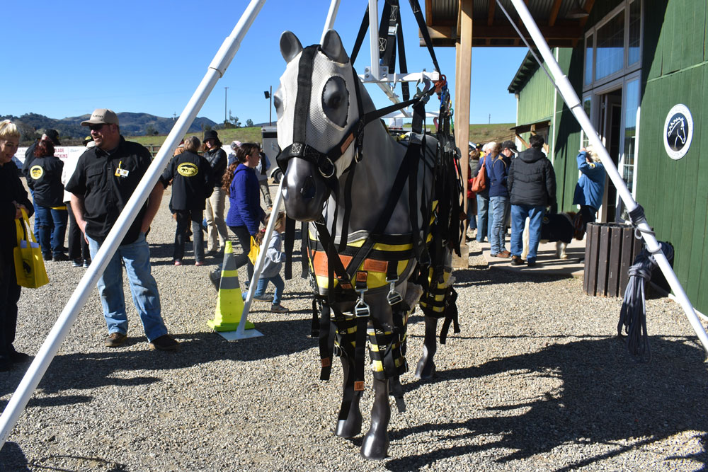 A plastic horse in a harness stands outside the Equine Emergency Preparedness Expo on Saturday in the Santa Ynez Valley.