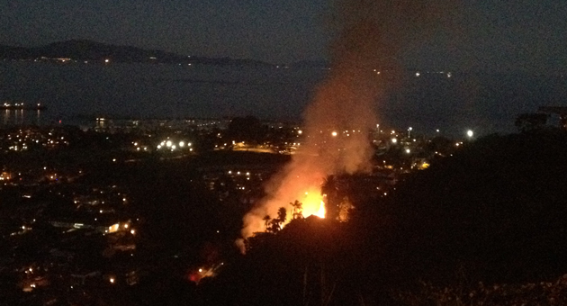 With darkness falling, flames burn in the vicinity of Loma Alta Drive near TV Hill on Santa Barbara's Westside Monday night. (John Palminteri / KEYT News photo)