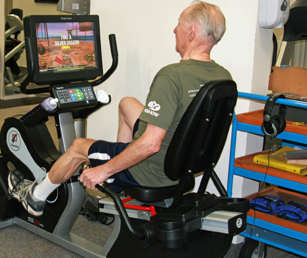 Don Chalfont, 79, puts exergaming to the test with Valle Verde's new recumbent bike. Chalfont can choose from a variety of courses and compete against fellow residents. (Valle Verde photo)