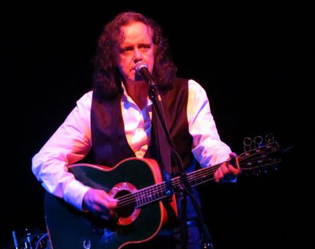 Scottish pop legend Donovan, 66, sings solo while playing acoustic guitar for the first set of his concert at the El Rey Theatre in Los Angeles. (Paul Mann photo)