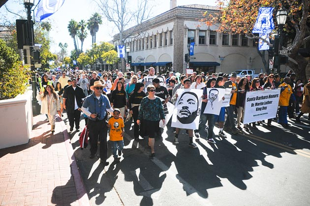 Hundreds of people march down State Street on Monday in celebration of Martin Luther King Jr. Day.