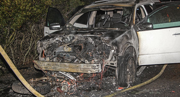 <p>The burned wreckage of a car and a motorcycle after an accident on Highway 101 near Refugio Tuesday night that sent two people to the hospital.</p>