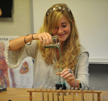 A Santa Barbara Middle School student measures liquids in preparation for a hands-on science experiment.