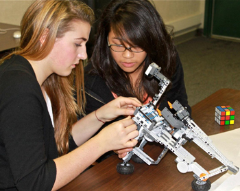 Ninth-graders apply the last pieces to their complex Rubik's Cube-solving robot.