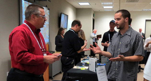 <p>Job seekers meet with representatives at a career fair and technology symposium Thursday at Network Hardware Resale&#8217;s headquarters in Goleta.</p>