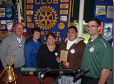 El Puente School student Edgar Lara, second from right, is honored by, left to right, Rotary Club of Santa Barbara Sunrise President Joe Weiland, Rotary member Susan Klein-Rothschild, mother Mirna Lara and teacher Cory Adam.